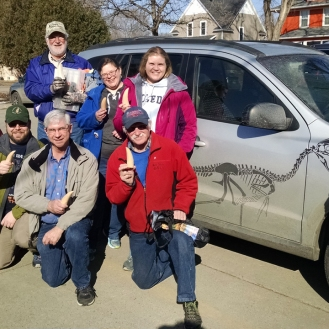 March 3rd project by Dale Heglund and Becky Barnes (Tyrannosaur teeth). Finished teeth, posed next to the dino-mobile!