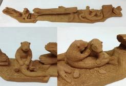 Member carving - otters in cottonwood bark